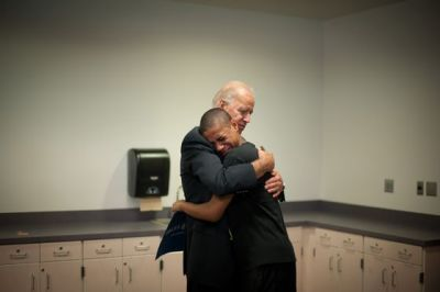 Joe Biden gets a pretty intense hug from 15 year old Kobe Groce. Read more about the picture.