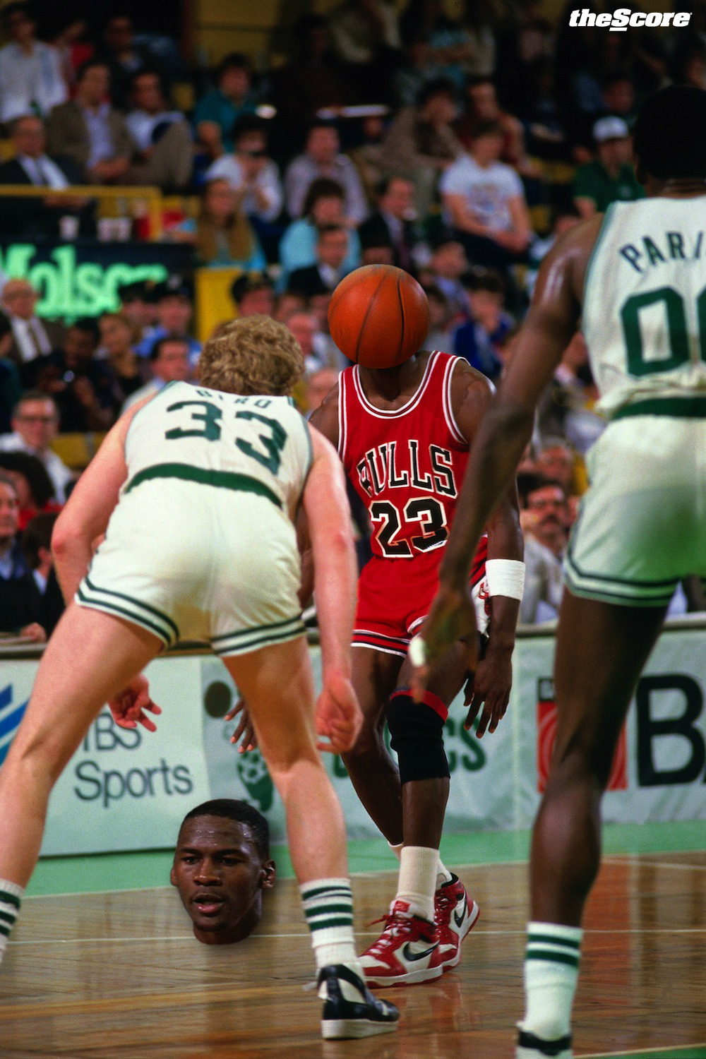 Michael Jordan sees an opening between Larry Bird's legs.