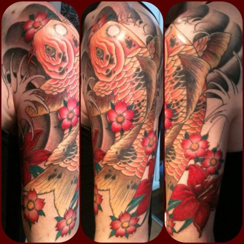 fuckyeahtattoos:  my koi half sleeve after its 4th session…not long to go now, loving it so far,all done by Hannah Westcott @ lucky 13 tattoo in Leicester