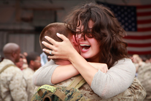 ask-a-marine:  VMAQ-2 Marines return from Afghanistan [Image 1 of 3] - Cpl. Colton Duran, an aircraft mechanic for the EA-6B Prowler with Marine Tactical Electronic Warfare Squadron 2, hugs his wife Cathia during a return ceremony at the squadron's hangar aboard Marine Corps Air Station Cherry Point, N.C. More than 100 Marines with the squadron returned from a six-month deployment to Afghanistan Oct 2. 2nd Marine Aircraft Wing & Marine Corps Air Station Cherry Point Photo by Lance Cpl. Stephen Stewart 2nd Marine Aircraft Wing & Marine Corps  Photo by Lance Cpl. Stephen Stewart Date Taken:10.02.2012 Location:CHERRY POINT, NC, US Read more: www.dvidshub.net/image/675534/vmaq-2-marines-return-afgha…  by DVIDSHUB http://flic.kr/p/dgHvDz