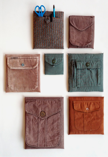 storagegeek:  Recycled Wall Pockets via Cuarto derecha Modern take on the traditional recycled wall pockets. Use dollar store canvases, a staple gun and some pockets from old clothing. Love this idea.