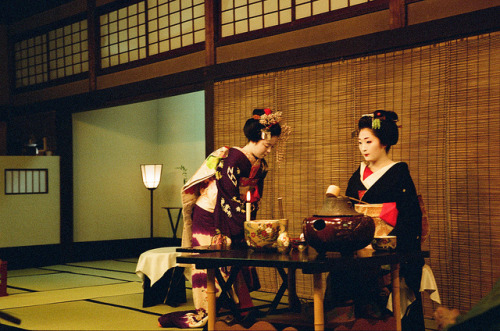 Geiko Katsugiku and maiko Katsuhina performing a tea ceremony during the 2012 Miyako Odori at Gion Kobu Kaburenjo.