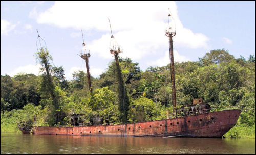 goliathii:  Rusty boat this time! Lightship Suriname 3. On station in Suriname from 1968. Decommissioned 1981. This ship served originally for 30 years as a relief lightship. Presently it is an abandoned hulk beached with its sister ship LV-106 on the Suriname River near Overbridge. Source : visible-shipwrecks