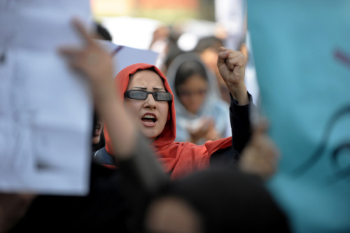 "intuitiveunderstanding:  ""An Afghan woman shouts as she and dozens of others marched to protest violence against women in Kabul on September 24, 2012. The death of a provincial head of the Ministry of Women's Affairs, and the public execution of a woman accused of adultery underscored the level of violence that Afghan women suffer. (Roberto Schmidt/AFP/GettyImages)"""