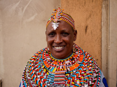 "esotericalesbians:  Rebecca Lolosoli in Umoja, Kenya (source)         Umoja is a small all-female village in Northern Kenya, comprised of women seeking refuge from sex-based violence. The word ""umoja"" translates from Swahili to English as ""unity."" Umoja was founded by Rebecca Lolosoli, and women who had left their husbands and families to live a life independent of the patriarchy and it's violent influences. Many women- homeless, runaways, or otherwise- have been attracted to Umoja. Young girls have evaded becoming child brides to older men by living under the rule of Lolosoli, a charismatic and strong matriarch in this small patch of Africa. The village is supported by a camping site and cultural center run by the villagers, as well as items made and sold by the women living in Umoja. The children living in and born in the village also have the opportunity to get an education, regardless of their sex. These children are also safe from horrors such as genital mutilation and rape, and have a chance to grow up learning of equality between the sexes.      Sebastian Lesinik, the patriarch of a rival village set up by angered men, is quoted by the Washington Post as having said of Lolosoli, ""She's questioning our very culture. This seems to be the thing in these modern times. Troublemaking ladies like Rebecca.""       Lolosoli is a troublemaker and a living feminist legend. Before she ever spoke at the United Nations during a conference on gender empowerment, she would go house-to-house in nearby town Archer's Post to inform women of their human rights. Today, the villagers of Umoji have withstood numerous trials, from death threats to a failed lawsuit and the village stands as a haven for Samburu women.  To learn more, or donate, visit their website at http://www.umojawomen.org/"
