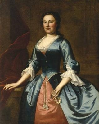 "Portrait of Mrs Samuel McCall, Sr by Robert Feke, 1746 US (Philadelphia), Museum of Fine Arts, Houston Thanks to mimic-of-modes for pointing out that the dress in this post is similar to this one, by the same artist.  The picture was found through their Pinterest. While the dress may have existed, it might have been painted from memory or copied from an image, such as an engraving. (The dress was probably artistic, not worn in everyday life.  The museum confirms this in the description below.) It was common practice in the 18th century, especially in colonial and early America, for artists to paint ready-made ""bases"", so to speak, on which to later fill in a clients' head or just their face.  This patron must have paid more for her portrait than the patron of the previous image, since this one is more detailed and has more naturalistic shading.  The source I've linked to at the American Folk Art Museum briefly talks about how one artist could have many different styles.  One of several portraits of Philadelphia's McCall family, this painting features a young woman standing erect in front of an Ionic column and beside a swath of crimson drapery and a Rococo marble-topped table on which she rests her hand. Imposing, elegant, and spare, it shows how Robert Feke provided dignified portraits for his clientele, whether in Philadelphia, Boston, Virginia, or Barbados. The first major native-born artist of the British North American colonies, Feke is known for his relatively large, impressive portraits. He borrowed from the tradition of Baroque portraiture, including swags of brightly colored drapery, columns, elegant dresses, and props. His grand portraits of colonists dressed and posed in the guise of English nobility evoke a quality of dignity and grace, and as exemplified in this excellent example, showcase a combination of grandeur and simplicity. At the time Feke painted Anne McCall, she had been married for nine years to her cousin, Samuel, a prominent Philadelphia merchant. Here, she is dressed in a radiant, crystal-buttoned, blue silk dress, with a salmon pink underskirt, accentuated at the narrow waist by a tassel belt. She gracefully holds a peony in her long, tapering fingers."