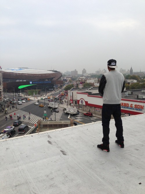 "Do you think Jay-Z is thinking, as he looks over the monstrosity that he has less than 1/15% stake in, ""Damn, this shit is uglier than the projects, but Hova don't care, because I get to act like it's mine."" howtotalktogirlsatparties:  ""On the roof at 560 State St. Words can't describe."" - Jay-Z"