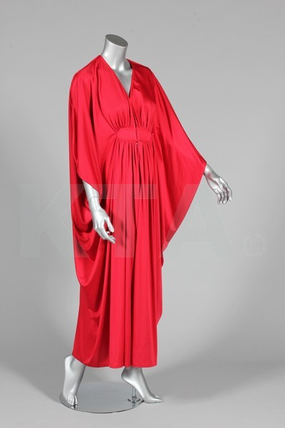Jersey evening dress by Yuki for Rembrandt, late 1970's Paris and UK (The designer lived in Paris but the tag indicates that the dress was made in the UK) The bust measures 92cm/36in, about a size 14 UK/10 US. Click to go to the absentee bidding page.  This Kerry Taylor auction will end October 16th at 10:30 AM GMT (5:30 AM EST).  You will need to register to bid ahead of time.