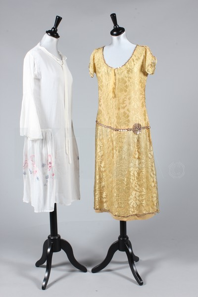 Dresses, 1920's The lot contains six dresses, evening jackets, feather boas, capelets,  two sequined boleros, lingerie, two pairs of shoes, a parasol and other items from the 1920's-30's. Click to go to the absentee bidding page.  This Kerry Taylor auction will end October 16th at 10:30 AM GMT (5:30 AM EST).  You will need to register to bid ahead of time.