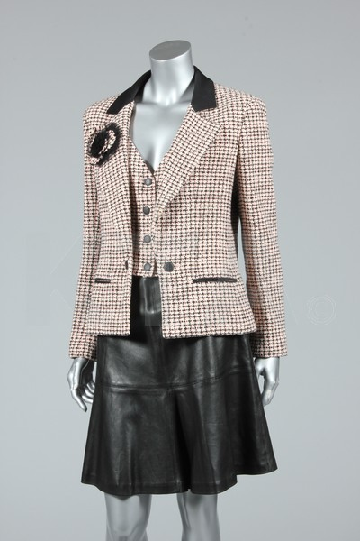 3 piece suit by Chanel, 1990's Paris Bust is 97cm/38in, waist is 82cm/32in, about a size 16 UK/12 US. Click to go to the absentee bidding page.  This Kerry Taylor auction will end October 16th at 10:30 AM GMT (5:30 AM EST).  You will need to register to bid ahead of time.