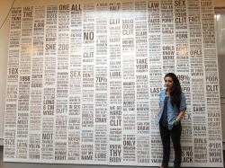 Sophia Wallace in front of CLITERACY, 100 Natural Laws in her Brooklyn Studio