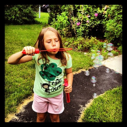 #bubbles #sister #grass #girl #child (Taken with Instagram)