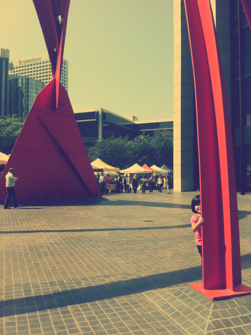 A peak-a-boo round at the Four Arches (1975) at the BOA Farmers Market, DTLA. These days are borrowed, the times of rearing your own child are lost and I am part of the cause.  A desire for house work and lust for ambition makes for ambiguous decisions.