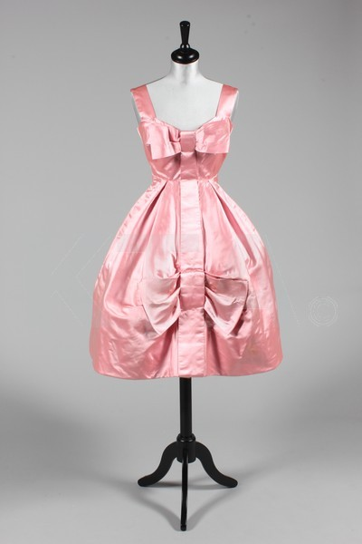 Cocktail dress by Rahvis, mid-1950's UK Bust is 86cm/34in, waist (which is boned) is 61cm/24in, about a size 8 UK/4 US. Click to go to the absentee bidding page.  This Kerry Taylor auction will end October 16th at 10:30 AM GMT (5:30 AM EST).  You will need to register to bid ahead of time.