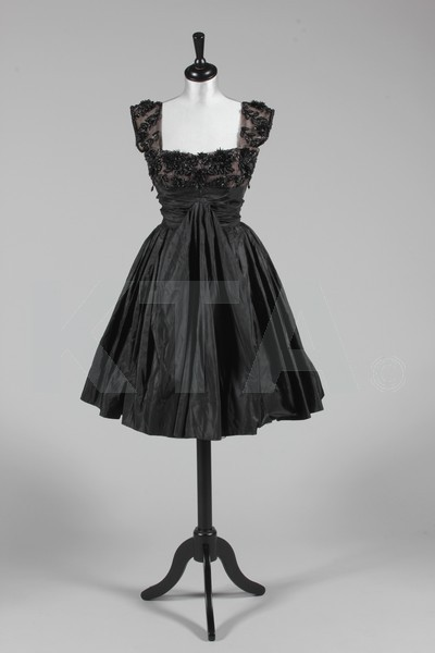 Evening dress by Rahvis, mid-1950's UK Bust is 92cm/36in, waist is 61cm/24in, about a size 12 UK/8 US with a very small waist. Click to go to the absentee bidding page.  This Kerry Taylor auction will end October 16th at 10:30 AM GMT (5:30 AM EST).  You will need to register to bid ahead of time.
