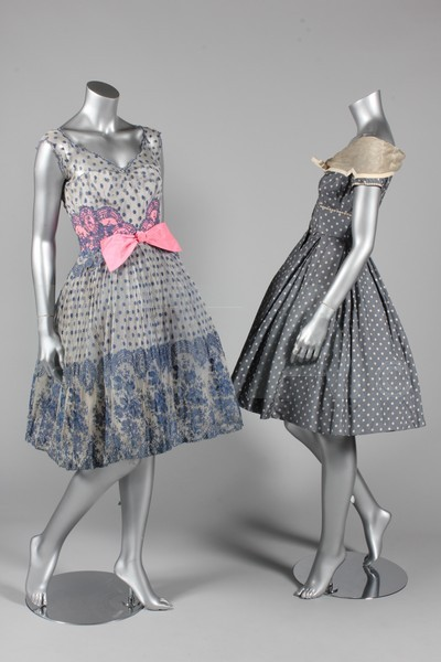 (Left) Cocktail dress by Rahvis, mid-1950's UK (Right) Day dress, 1950's? - Bust is 86cm/34in, waist is 56cm/22in, about a size 8 UK/4 US with a very small waist. Click to go to the absentee bidding page.  This Kerry Taylor auction will end October 16th at 10:30 AM GMT (5:30 AM EST).  You will need to register to bid ahead of time.