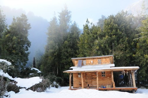 cabinporn:  Mountain cabin in Futaleufu, Chile.  Built with only a hammer and hand saw, 100% off-grid with solar and hydropower. Submitted by Jon Clark.