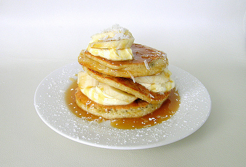 Coconut pancakes topped with bananas.