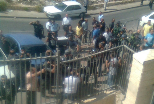 "Israeli police shut down, attempt to raid Palestinian school in East Jerusalem The Israel Police yesterday shut down a Palestinian school in East Jerusalem for a period of a week. The school has over 1,200 students between the ages of 12 and 18 years old. The police justified their actions to the students and teachers by voicing suspicion that stones were thrown at settlers by students from the school. +972 magazine learned from students and teachers that the school doesn't allow students to throw stones from the school, but they cannot monitor students outside the school. It is unreasonable and unrealistic, a teacher said, ""to be held responsible for individual students' actions outside the parameters of the school."" Earlier in the day, stones were thrown in the At-Tur neighborhood at settlers, and one of them was hit. The police arrived immediately to the scene and launched an attack at the school, suspecting that students were involved in the stone-throwing. Residents from the neighborhood and teachers clashed with the police and stopped them from storming the school and arresting students. According to eye witnesses, the police resorted to punishing the teachers by issuing traffic violations and parking tickets to them upon leaving the school."