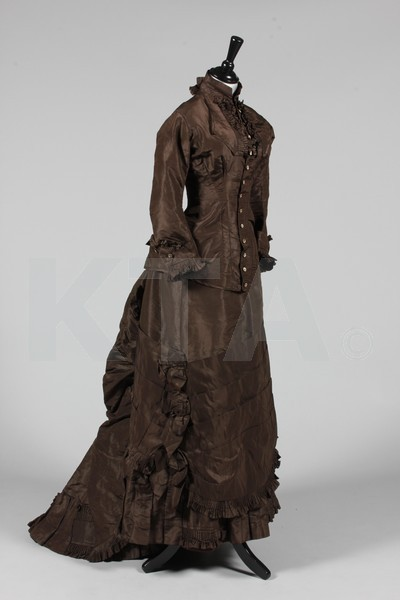Promenade dress, ca 1875 Click to go to the absentee bidding page.  This Kerry Taylor auction will end October 16th at 2:00 PM GMT (9:00 AM EST).  You will need to register to bid ahead of time.