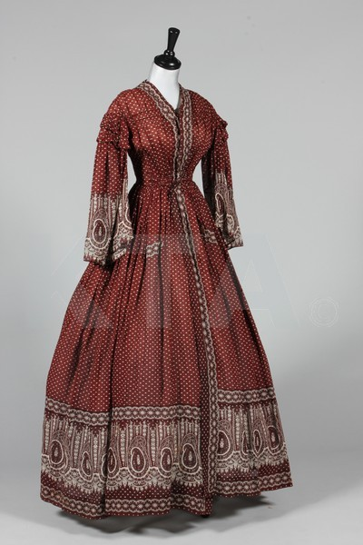 Wrapper, ca 1855 The lot also includes a day dress (ca 1850), a spencer (ca 1820) and a bodice (ca 1800). Click to go to the absentee bidding page.  This Kerry Taylor auction will end October 16th at 2:00 PM GMT (9:00 AM EST).  You will need to register to bid ahead of time.