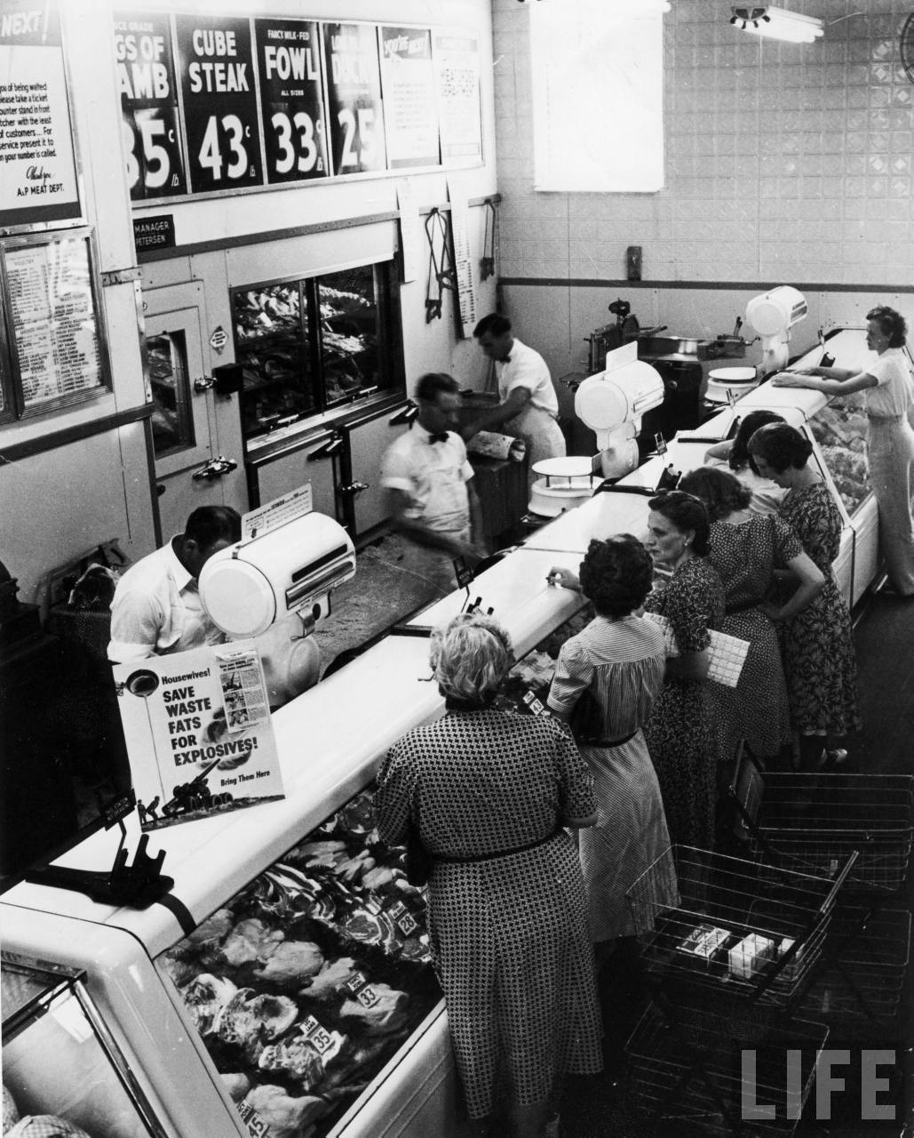Shoppers at the butcher counter of A&P grocery store. Garden City, 1942. By Alfred Eisenstaedt