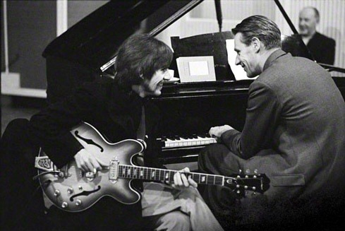 theswinginsixties:  George Harrison in the studio with George Martin.