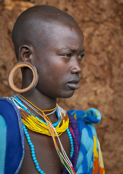 hiddenpeponi:  Suri woman with big ear rings, Kibish, Ethiopia by Eric Lafforgue on Flickr.