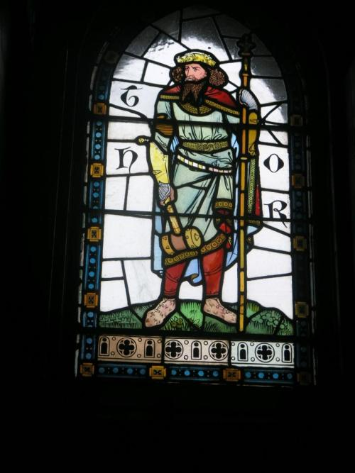 A stained glass window depicting Thor in Castle Cardiff, Wales.