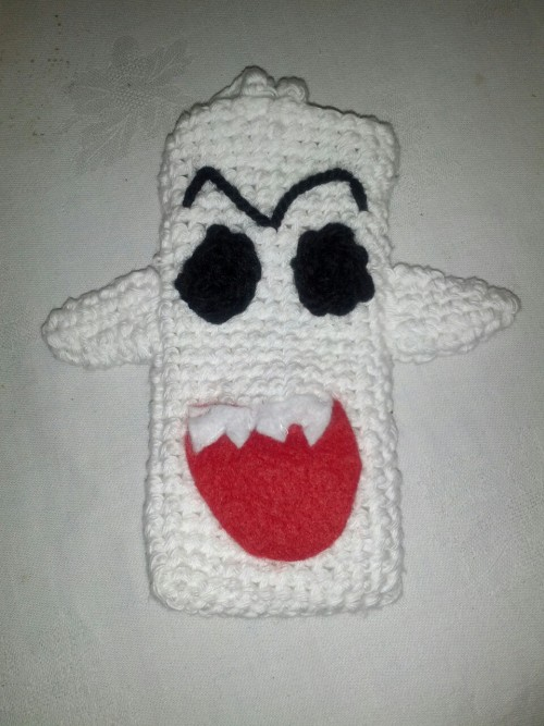 I finished my Boo (Super Mario ghost) phone cover. I am very happy and proud although I am aware it doesn't really look like the real thing and my stitching is pretty bad.. screw it, who cared, I like it!