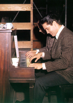 vinceveretts:  Elvis playing piano on the set of 'Wild In The Country'.