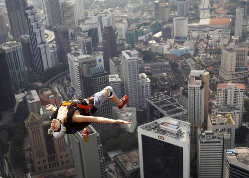 Malaysia French BASE jumper Florian Pays leaps from Malaysia's landmark KL Tower, the 421-meter (1,389-foot) broadcasting tower in downtown Kuala Lumpur, Sept. 29.Vincent Thian/AP