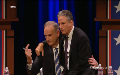 """And what would you like for Christmas, little boy?"" Jon Stewart's reaction to a question asking what advice they'd give Congress on working together was to sit on Bill's lap."