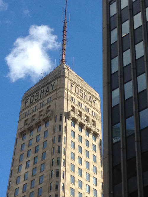 "Foshay Tower, Minneapolis, Minnesotaby Caleb Racicot A closer look at the tower. Interesting trivia from Wikipedia:  Foshay Tower was the lifelong dream and namesake of Wilbur Foshay, an art student turned businessman who amassed his fortune by building up three utility company empires (operating as the W. B. Foshay Company). At the time the tower was being built, he had sold his previous two empires in turn and was building up his third (which was eventually to stretch from Alaska to Nicaragua). He planned to locate his business and residence on the twenty-seventh and twenty-eighth floors where a three-bedroom, three-bath suite was built, with a fireplace and library, Italian Siena marble walls and glass-paneled ceilings. Foshay invited 25,000 guests to the dedication ceremony and provided all-expenses paid trips to many who included cabinet members, senators and congressmen. Half-nude dancers entertained. Each guest received a gold pocketwatch. The military gave 19-gun salutes. John Philip Sousa conducted music, including ""Foshay Tower–Washington Memorial March"" a march he wrote for the occasion. Foshay presented Sousa with a check for $20,000. The march was only played once during Foshay's lifetime. Six weeks after the building's opening on November 2, 1929, Foshay's corporate empire was thrown into receivership at the onset of the Great Depression. Ignominiously, Foshay's check to Sousa bounced, and in retaliation, Sousa prohibited the playing of the march so long as Foshay's debt to him remained outstanding. Foshay never lived in his new home, which also went into receivership. It wasn't until 1988 when a group of Minnesota investors repaid Foshay's debt to Sousa's estate that the march was permitted to be played in public again.  Here it is on Street View."