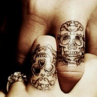 inkmeplease-3:  skulls…matching, cute!