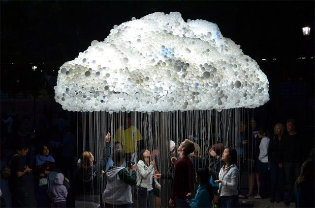 CLOUD is a large scale interactive installation by artist Caitlind r.c. Brown that appeared September 15th as part of Nuit Blanche Calgary in Alberta, Canada. The piece is made from 1,000 working lightbulbs on pullchains and an additional 5,000 made from donated burnt out lights donated by the public. Visitors to the installation could pull the chains causing the cloud to sort of shimmer and flicker.