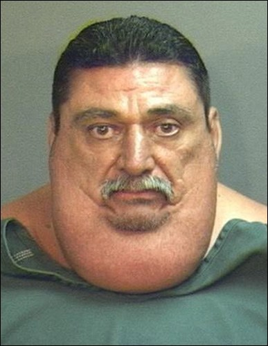 thedailywhat:  Mugshot of the Day: The jailhouse apparently ran out of size XXXXXXXL jumpsuits. [huffpo]