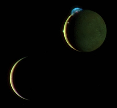 michaelvthesecond:  Io and Europa  This image of the crescents of volcanic Io and more sedate Europa was snapped by New Horizons' color Multispectral Visual Imaging Camera (MVIC) on March 2, 2007, about two days after New Horizons made its closest approach to Jupiter. [Image:NASA/JPL/New Horizons]