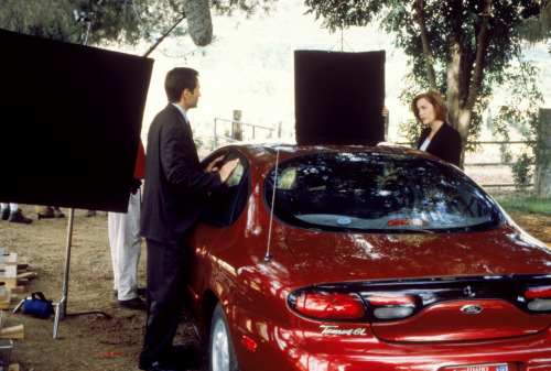 Anderson and Duchovny are in a stationary car. Until the director says, 'Action!', which is the exact moment they become Mulder and Scully, the two actors do not speak to, or even look at, each other. Observer, Feb 1999