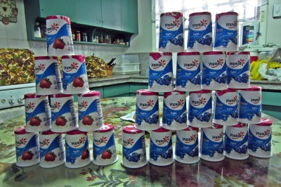 Yogurt Towers!!! Strawberry yogurt vs. blueberry yogurt. :PSo my father came home from Hawaii today and look what he brought home! A ton of Yoplait! I loooooove this brand. I usually don't eat yogurt by itself unless it is frozen or mixed into a smoothie, but this brand is so delish that I can eat it as is.  I LOVE YOPLAIT. I LOVE MY DAD. :>