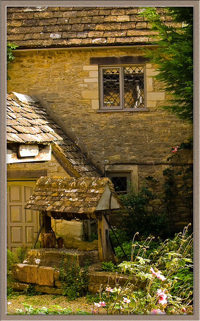 Old house with water well in Bibury, Gloucestershire by Anguskirk on Flickr.