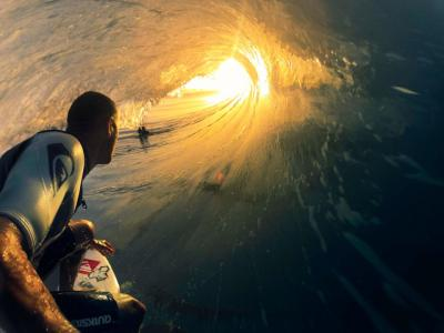 futurejournalismproject:  Passing Time in a Tube The News: Kelly Slater wins his 51st ASP World Tour event in France. Things we think we think: The photo was shot with a GoPro camera and mount. Image: Via Swell Magazine.  Hands down, one of the best surf shots I've ever seen.