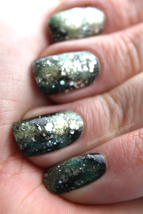 Finally got around to doing some galaxy nails. I used Essie's Licorice, Revlon Top Speed's Electric, OPI's Jade is the new Black, Sally Hanson's Colour Quick Gold Chrome, and OPI's Just Spotted the Lizard with Essie's Set in Stones for the stars.
