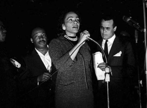 Dr. Martin Luther King Jr. and Harry Belafonte stand behind Coretta Scott King as she speaks at the 'Stars for Freedom' rally on the last night of the historic Selma to Montgomery march in support of voter rights in Montgomery, Alabama on March 24, 1965. Photo: Robert Abbott Sengstacke/Getty Images.