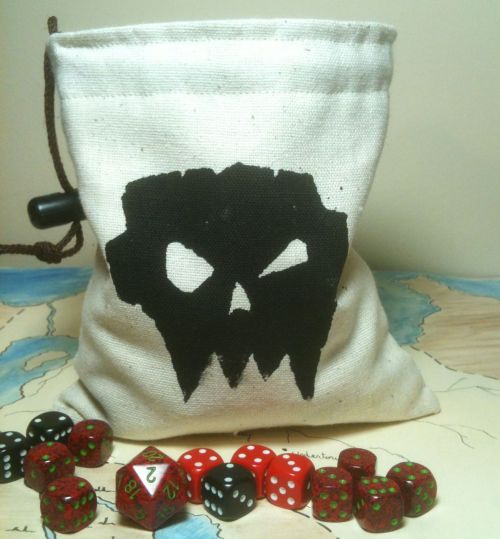 I really like making dice bags. I have a mid-size dice collection, and those dice all need a place to live. I feel like every gamer, roleplayer, tabletop wargamer, and dice enthusiast should have a really cool dice bag. I started, a few months ago, to screen print dice bags with various images, and I think I'm finally figuring out how to do it right. This is one of my orc skull dice bags. I also make dice bags that stand open on the tabletop, which is pretty awesome when you want access to your dice but you don't want a huge dice pile on the gaming table. Greyed Out is having a Fall Sale right now where you can free shipping using the coupon code FREESHIP or 25% off your order using the coupon FALLBASH - the sale goes until October 31. You can find Greyed Out on Etsy. If you know someone who needs a new dice bag, please spread the word! Get your Christmas shopping done early, and see the 30+ dice bags I have available here.