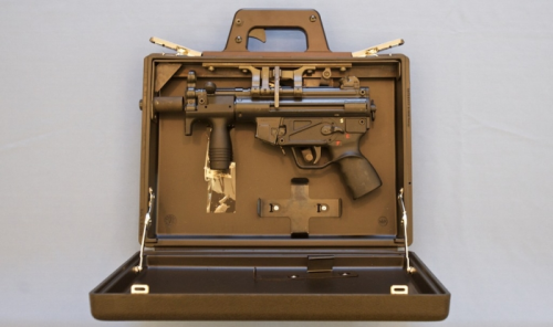 H&K MP5K Briefcase This was designed and sold by H&K with the intended market being special security services. The trigger is visible in the briefcase's handle which actuates the mechanism to pull the MP5K's trigger. A large cache of these were found in Iraq but I don't know what happened with them. Either destroyed or sold off to security contractors.