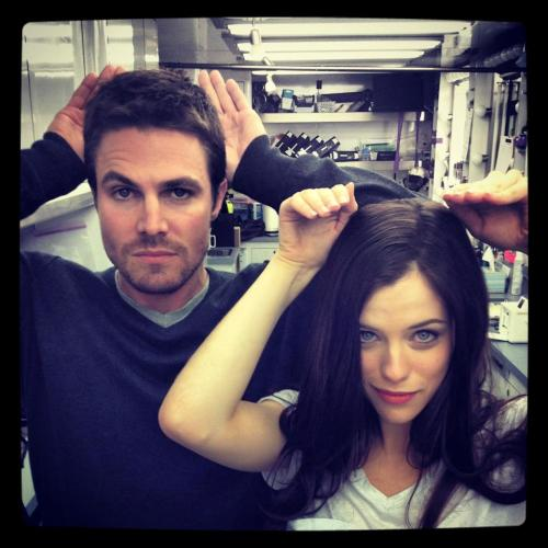 Stephen Amell and Jessica de Gouw being goofy for the camera. Still waiting for an official picture of the Huntress costume. :P