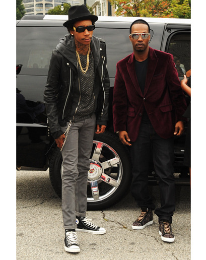 gqfashion:  If you're stacking black on black, a little texture—like Wiz's polka dots here—will keep you out of Herman Munster Land. The Week in Style