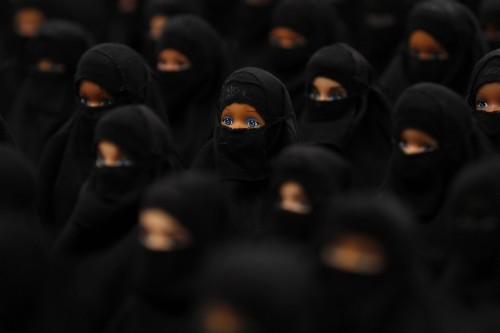 Making everything a mystery BURQA BARBIE: German artist Sabine Reyer's 'Sheltered Position,' which consists 100 Barbie dolls dressed in burqas, was displayed at the Ruhr-Biennale in Dortmund, Germany, Sunday. (Ina Fassbender/Reuters)