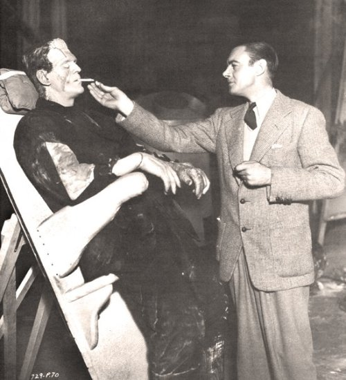 "the-asphalt-jungle:  Colin Clive lights Boris Karloff's cigarette during a break on the set of ""The Bride of Frankenstein"" (1935)"